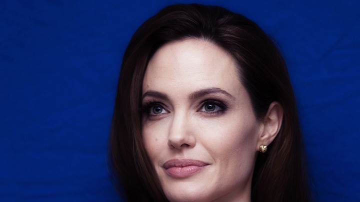 Angelina Jolie Sweet Smiling Face Closeup On Blue Background